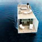 This Houseboat Was Designed With Vertical Slats That Allow Light In While Maintaining Privacy