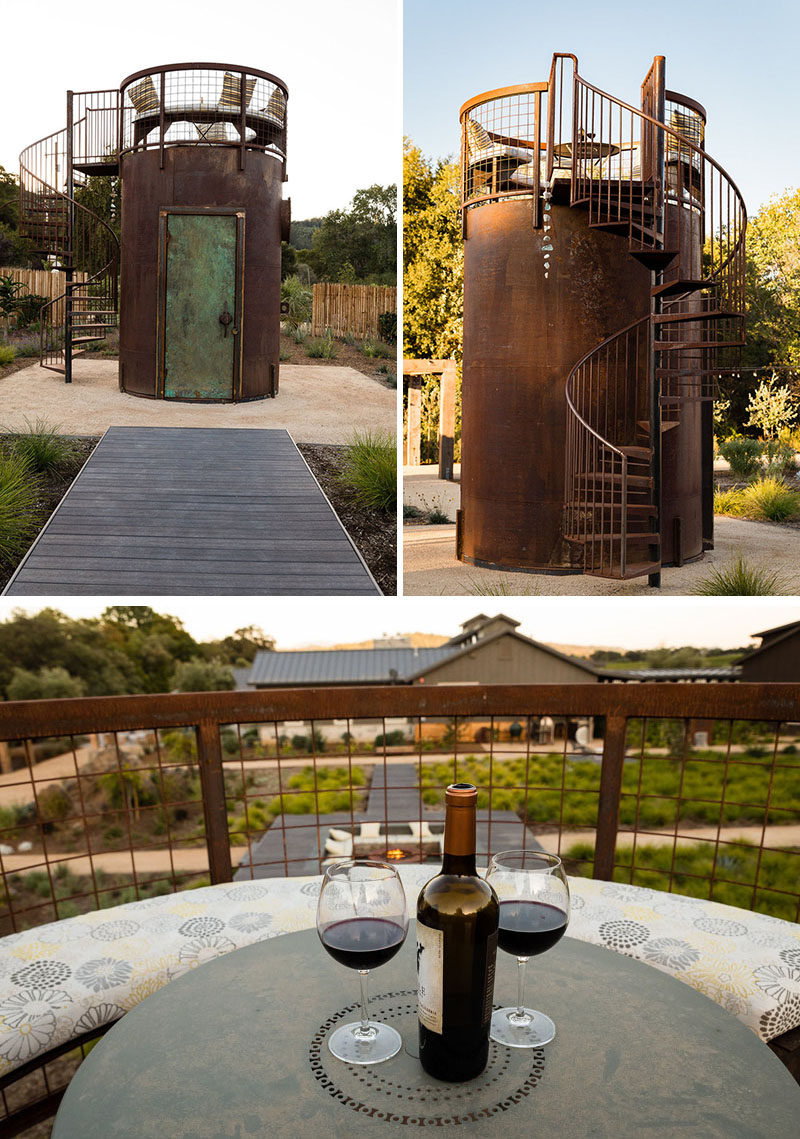To experience an alternate view of this backyard and to enjoy stargazing, a small steel tower has a spiral staircase that leads up to a seating area with a curved bench and a small table. #Backyard #Landscaping #Design