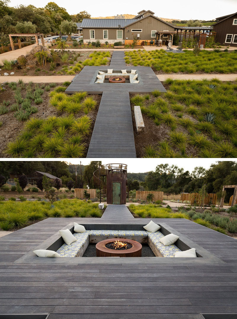 Central to this landscaped backyard is a raised wooden pathway that leads to a large sunken lounge with bench seating and a fire pit. #SunkenLounge #Landscaping #Firepit