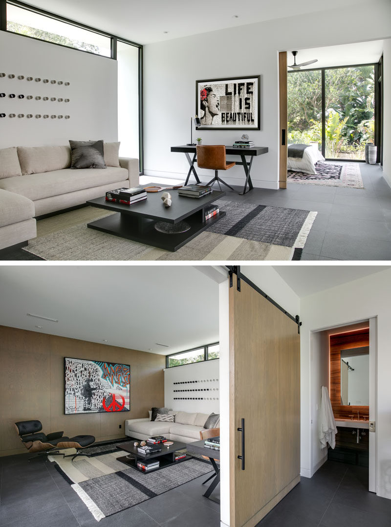 In this modern master suite, there's a private living room with a large sliding wood door separating it from the sleeping area. #MasterSuite #BedroomSuite #LivingRoom #SlidingDoor