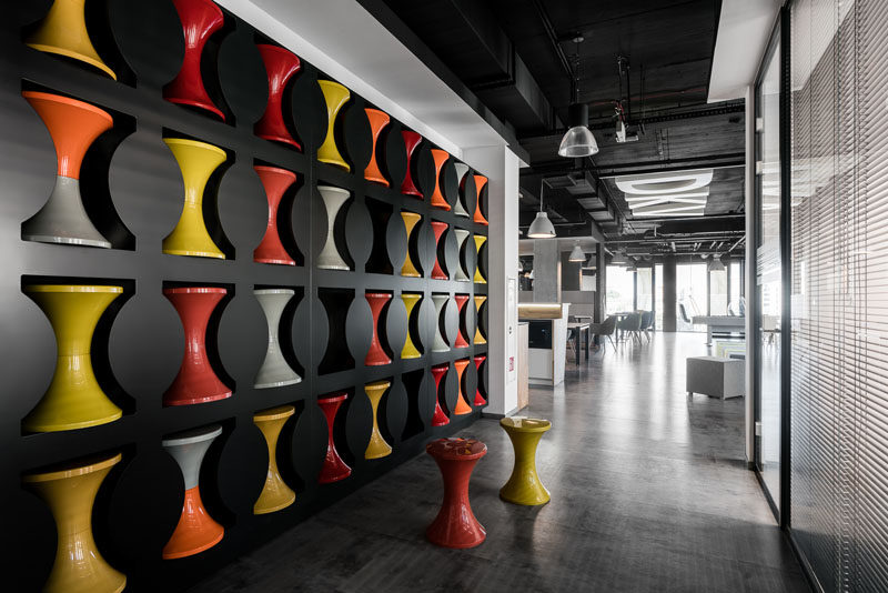 Design Detail – A Wall In This Office Was Used To Create Stool Storage