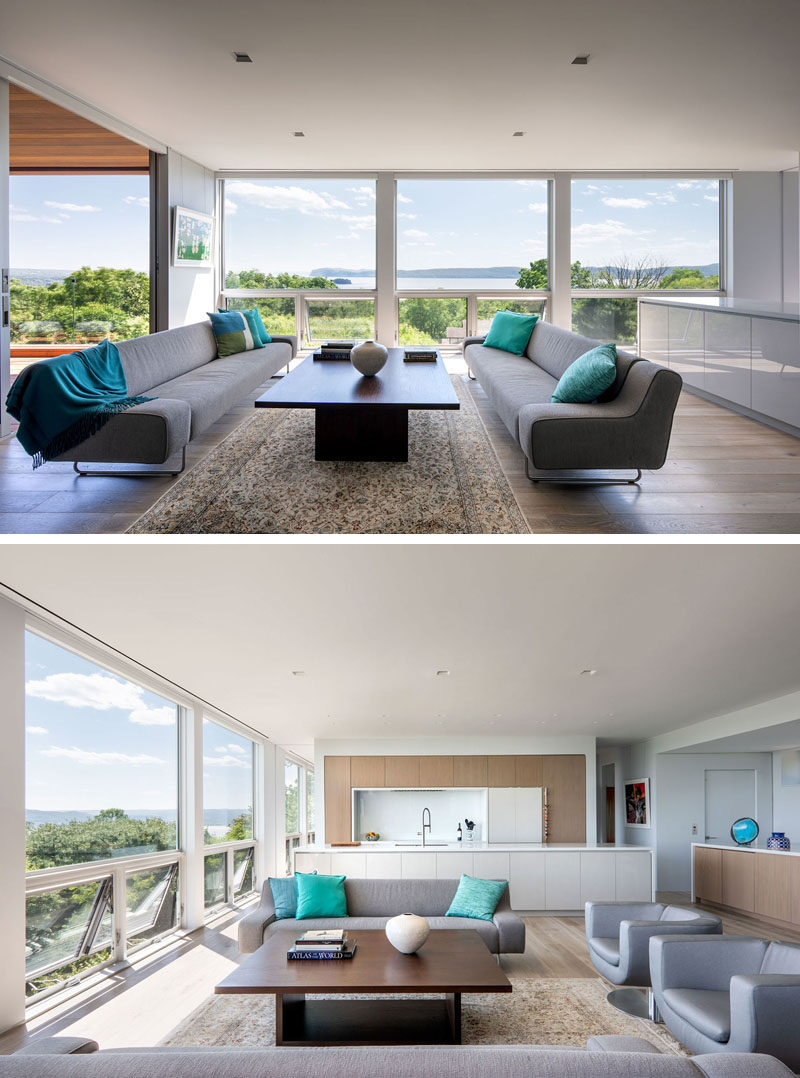 Floor-to-ceiling windows maximize the panoramic views of the town and river below. #Windows #LivingRoom #InteriorDesign #ModernInterior