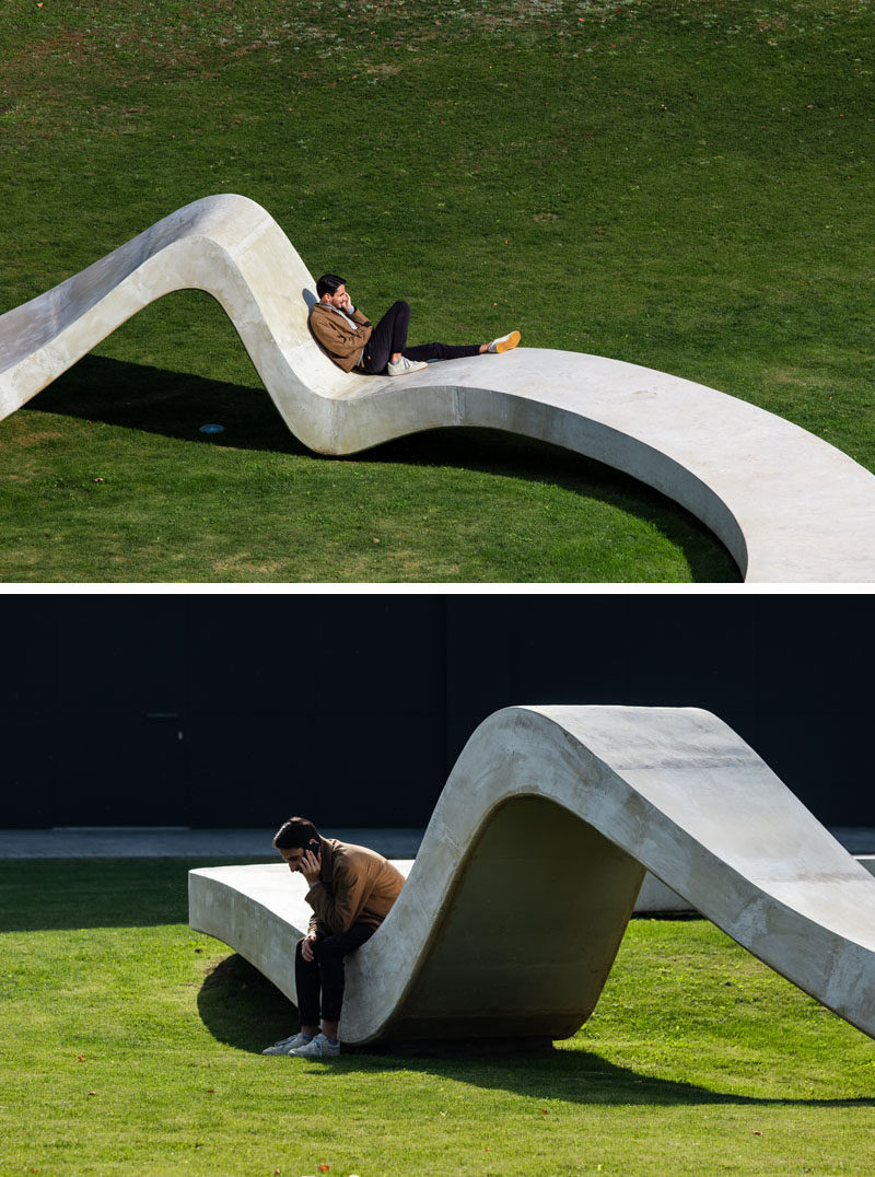 This modern concrete sculpture has been designed to allow people to relax and enjoy the design, with various high and low points creating places to sit or lean. #Sculpture #PublicArt
