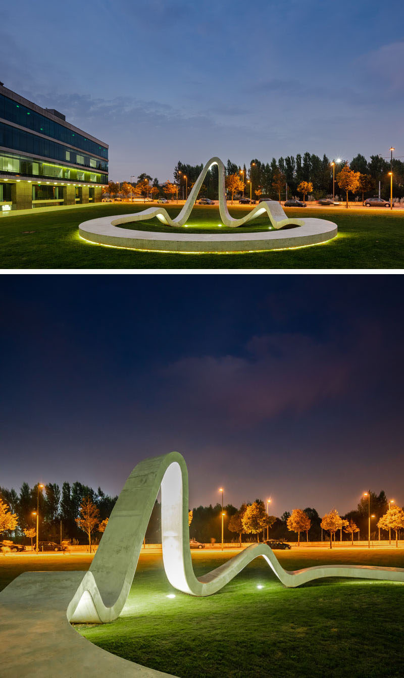 At night, lighting highlights the form of this modern sculpture and draws attention from people passing by. #Sculpture #Art
