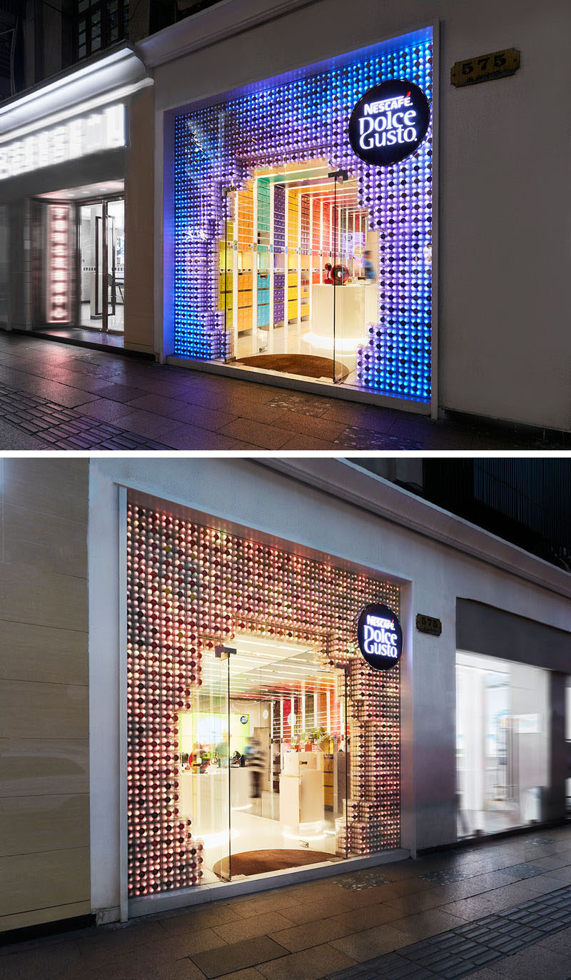 The facade of this modern store is composed of 3000 coffee capsules, which has the ability to change color with the use of programmable LED lights, which are located within 1000 white capsules, making each of them like a single pixel. #RetailStore #RetailDesign #StoreFacade