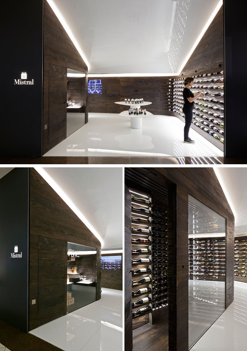 Studio Arthur Casas have designed a wine store and bar in Sao Paulo, Brazil, that features walls of dark wood that showcase the available wines. #WineStore #RetailDesign #WineBar #WineStorage