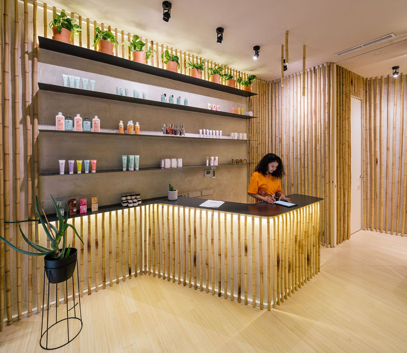 This modern spa has backlit bamboo accents around the service counter, treatment rooms, and hallways. #Bamboo #Spa #InteriorDesign