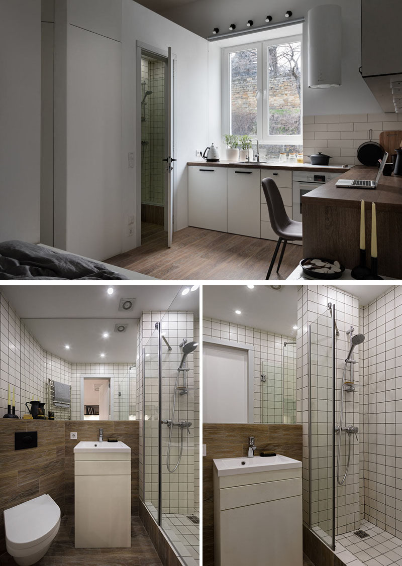 This small bathroom features a walk-in shower, a small vanity, a large mirror, and a wood shelf that provides a place for displaying various bathroom items. #Bathroom #SmallBathroom