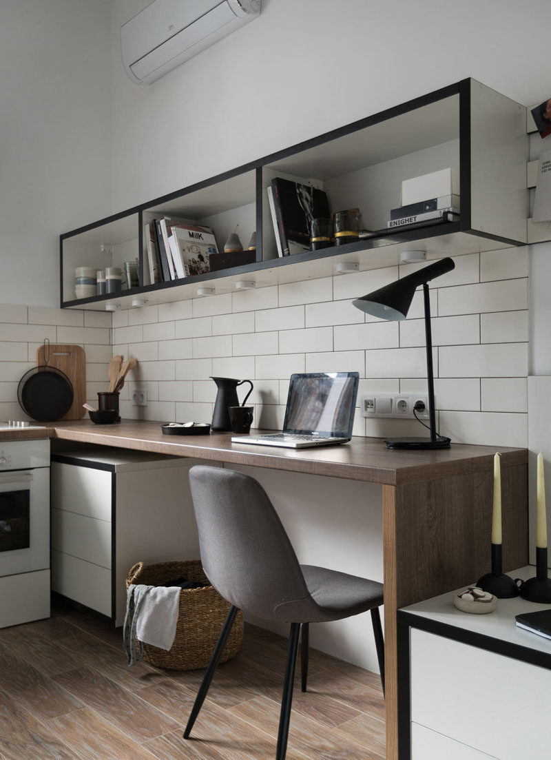 In this small apartment, the bedside table meets a wooden work desk, and above the desk is a floating shelving that can be used as a bookshelf and as a open pantry. #Desk #HomeOffice #InteriorDesign