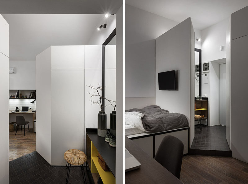 The tiny apartment has a small angled entryway with a mirror, shelf, stool, and wardrobe. #Entryway #SmallApartment