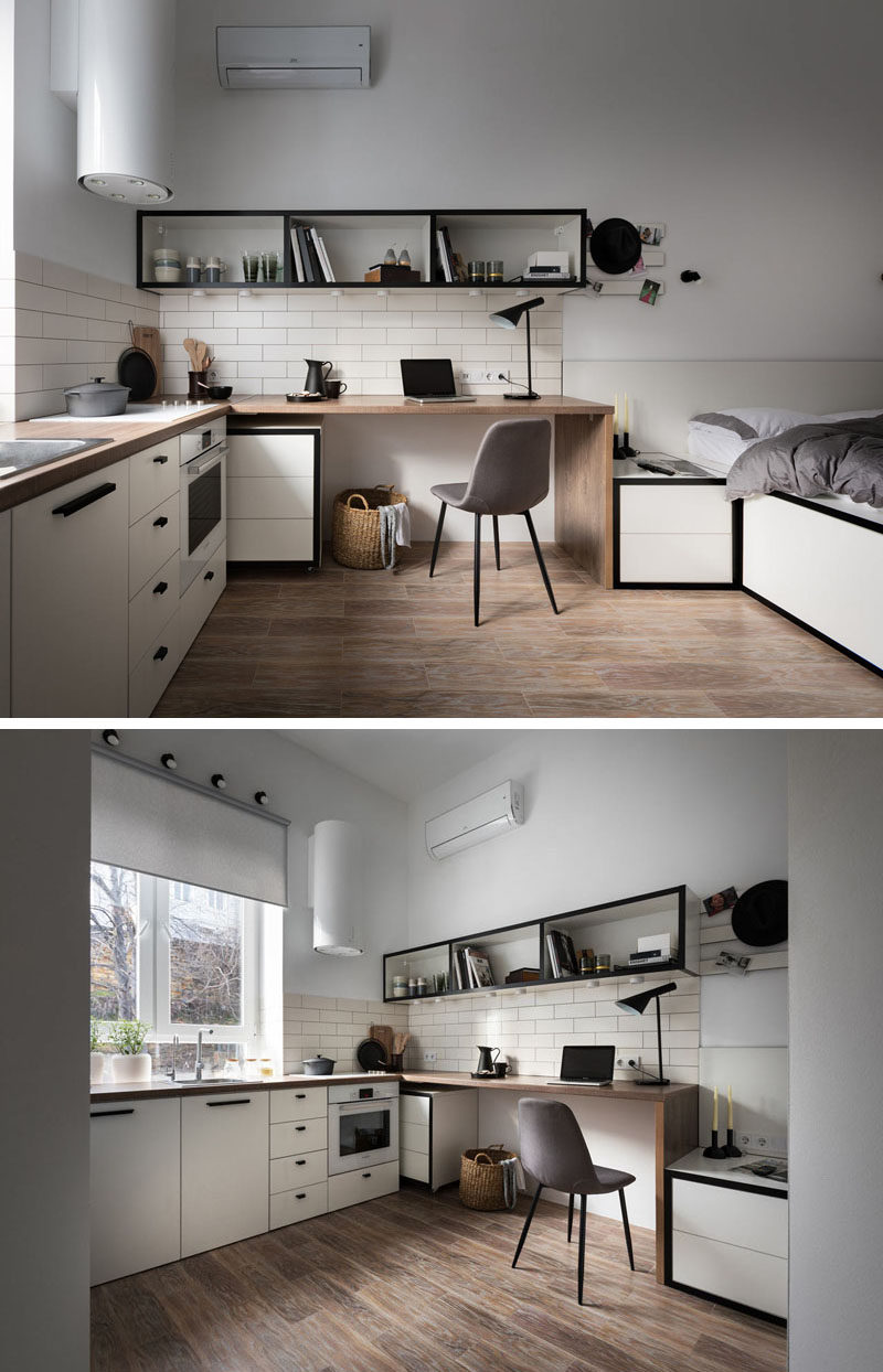 In this small apartment, the wood desktop morphs into the kitchen counter, that features a minimalist cooktop. A tall window allows for natural light to fill the small space, while cabinets and drawers below, create extra storage space. #Desk #SmallApartment #Kitchen