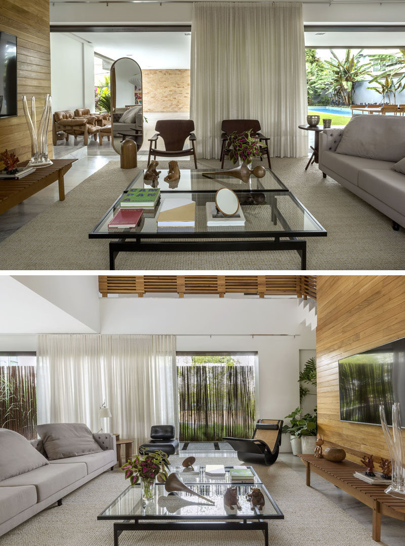 Sliding glass walls connect the exterior spaces to the interior spaces, like the living room and the dining room. #LivingRoom #Curtains #SlidingGlassDoors