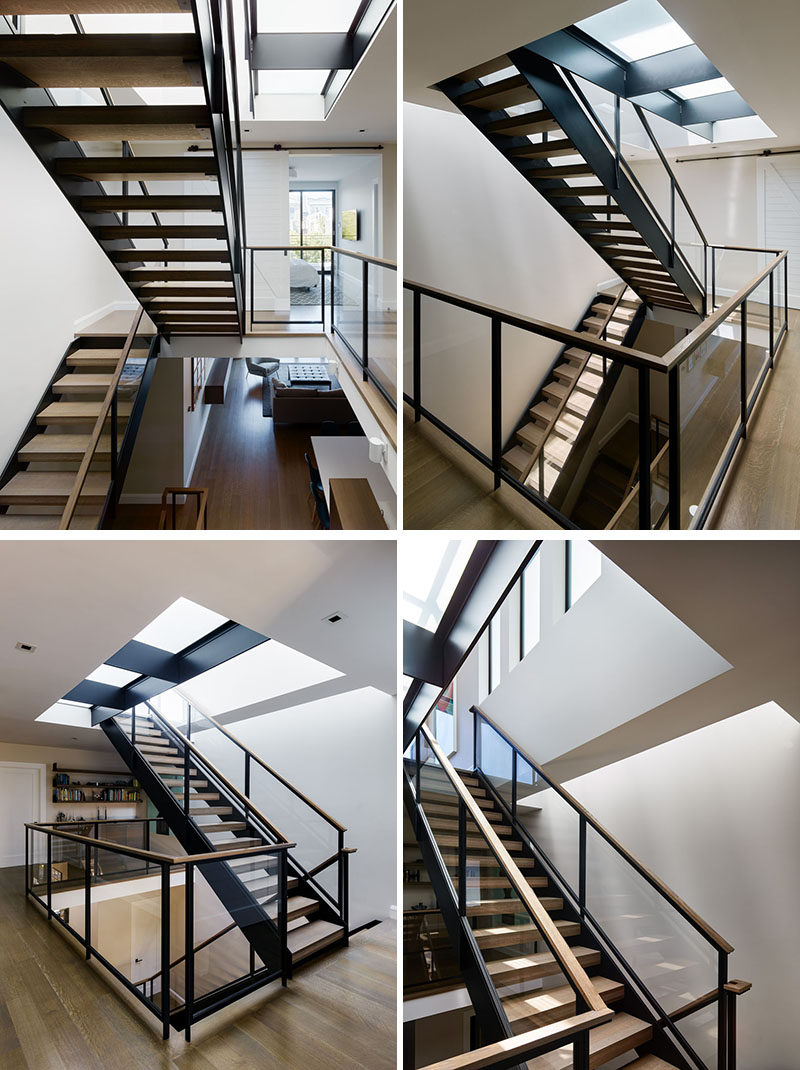 A staircase, comprised of solid oak treads and a steel and glass rail, connects all four levels of this modern house, channeling light from multiple skylights and diffusing it throughout the interior living spaces from the roof deck to basement. #Stairs #Staircase #ModernStairs