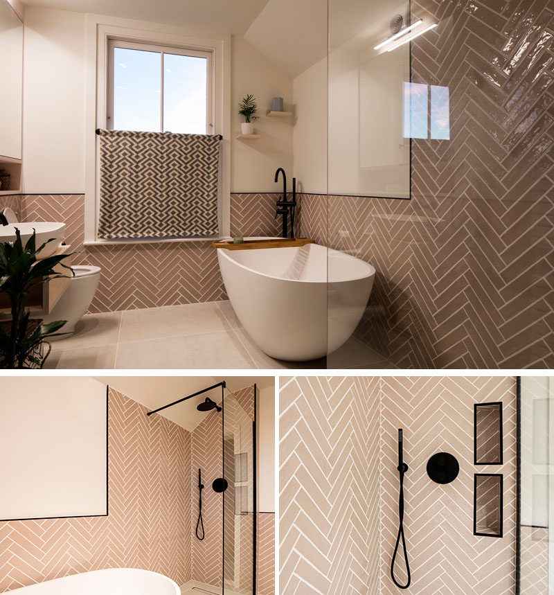 This updated bathroom by Woodrow Architects features tiles laid in a herringbone pattern that wrap around the walls, and a freestanding bathroom positioned next to a shower with black accents. #BathroomDesign Visit Woodrow Architect's website here > https://www.wdrw.co.uk