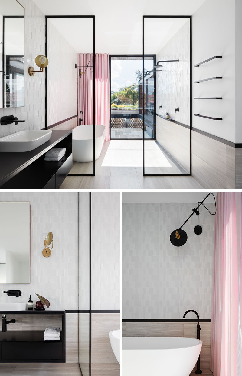 In the master bathroom, black-framed glass shower screens separate the wet areas of the bathroom from the dry. Pink curtains at the end of the bathroom add a soft and colorful touch to the space. #ModernBathroom #BathroomDesign