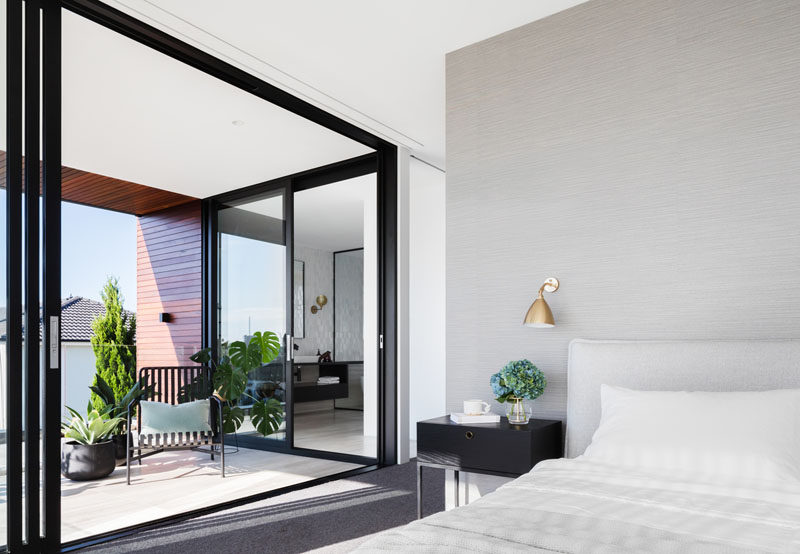 In this modern master bedroom, large sliding doors open to a private balcony, that also has a second sliding door to the master bathroom. #MasterBedroom #Balcony