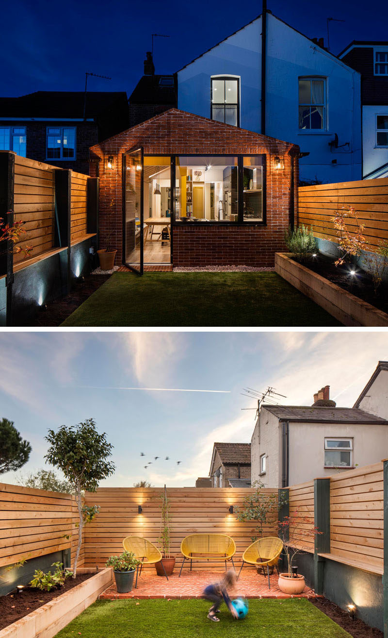 This brick extension by Woodrow Architects opens up to a small landscaped yard with a raised planter bed on one side, and a patio area at the back. #BrickExtension #Backyard #Patio Visit Woodrow Architect's website here > https://www.wdrw.co.uk