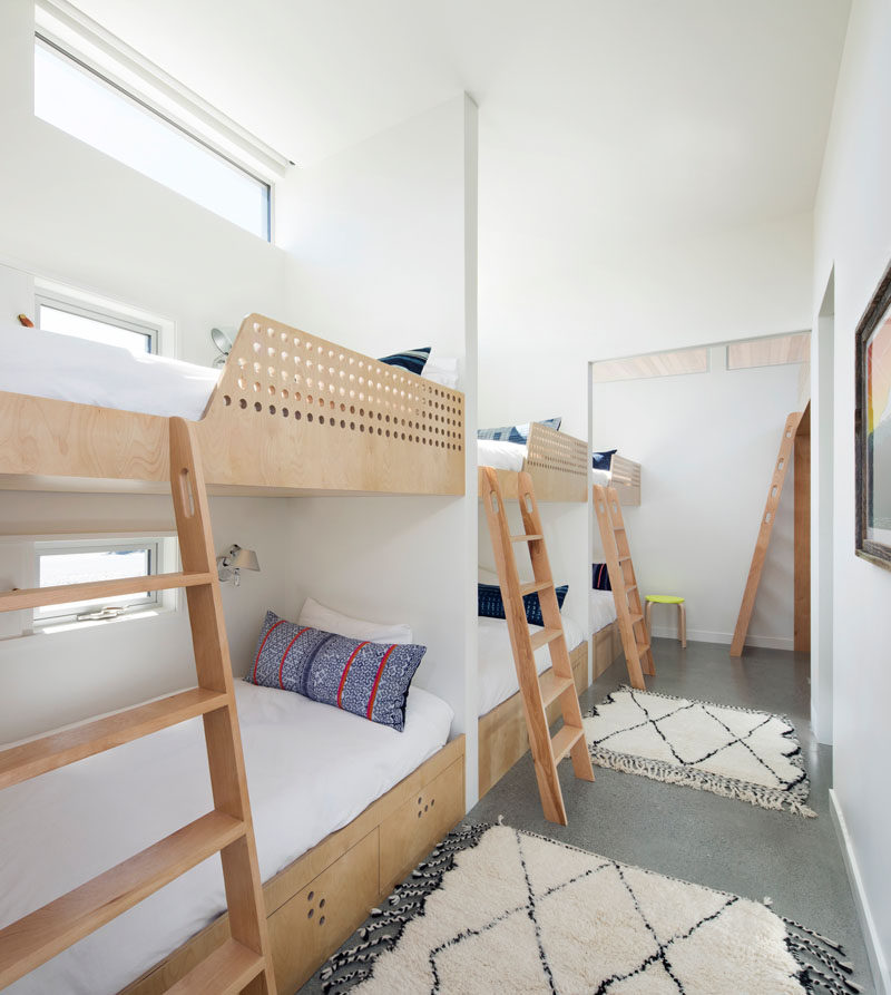 This modern house has a'bunk room', with three double bunks and one loft, sleeping a total of seven. Each of the bunks has its own small window and reading light. #BunkBeds #Bedroom