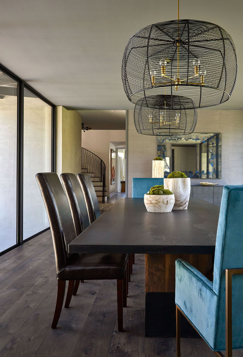 This dining room is located within a bridge with glass walls, that connects the various areas of the house. #DiningRoom