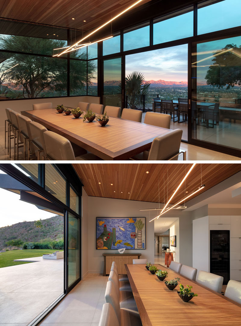 Plenty of windows and glass doors provides this dining room with sweeping views and natural light. #DiningRoom