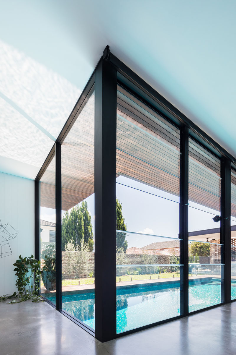 Large floor-to-ceiling black-framed windows provide views of the pool and let an abundance of natural light through to the interior of this modern house. #Windows