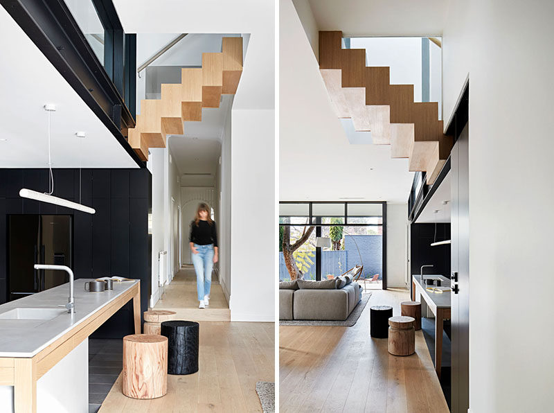 In this renovated house, a simple hallway leads to the open plan kitchen, dining room, and living room. #InteriorDesign