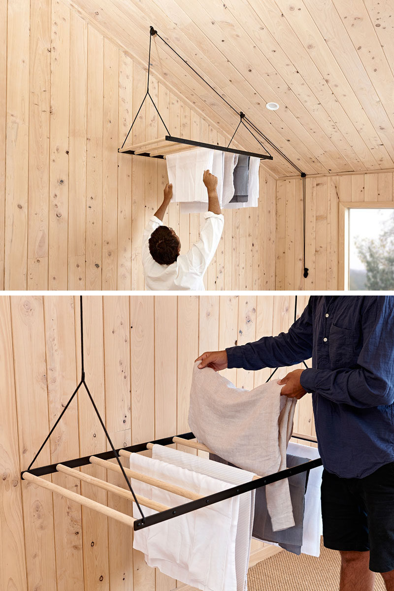 George and Willy have created a modern hanging drying rack, that's suspended from the ceiling using a seamless pulley system, allowing the clothes rack to quickly dry laundry by utilising warm air trapped in the ceiling space. #HangingDryingRack #Design #Laundry