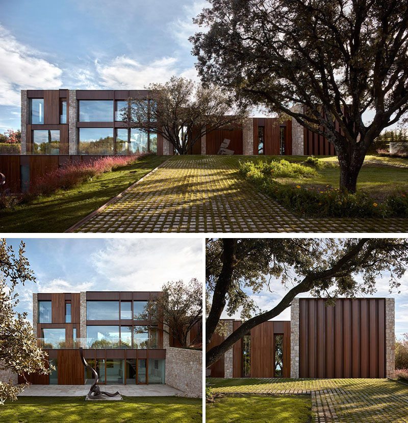 Surrounded by lush vegetation and some ancient Holm oak trees, this modern house was designed around the trees to respect the land. #ModernHouse #Architecture