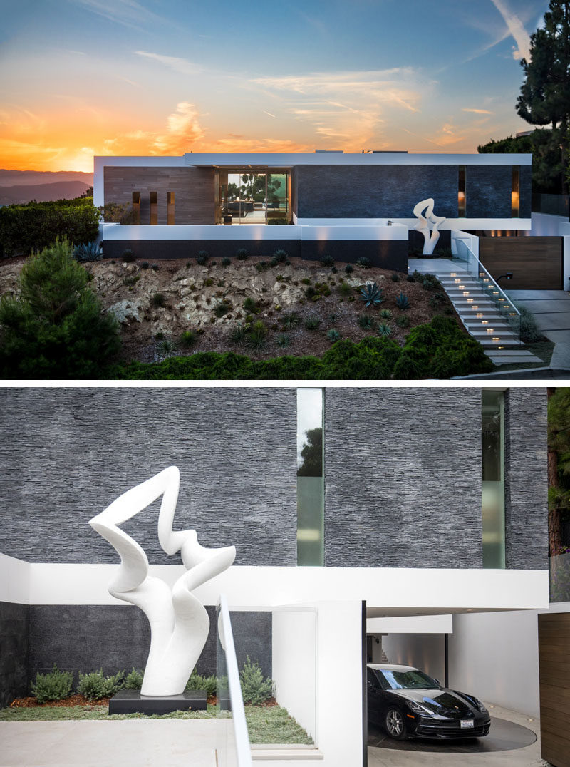 Guests coming up the front steps of this hilltop home are met with a Carrera marble sculpture by Richard Erdman, titled 'Serenade', while the car park features a turntable that identifies each car, rotates it to a preset angle that enables the driver to exit with ease. #ModernHouse #HouseDesign #Architecture