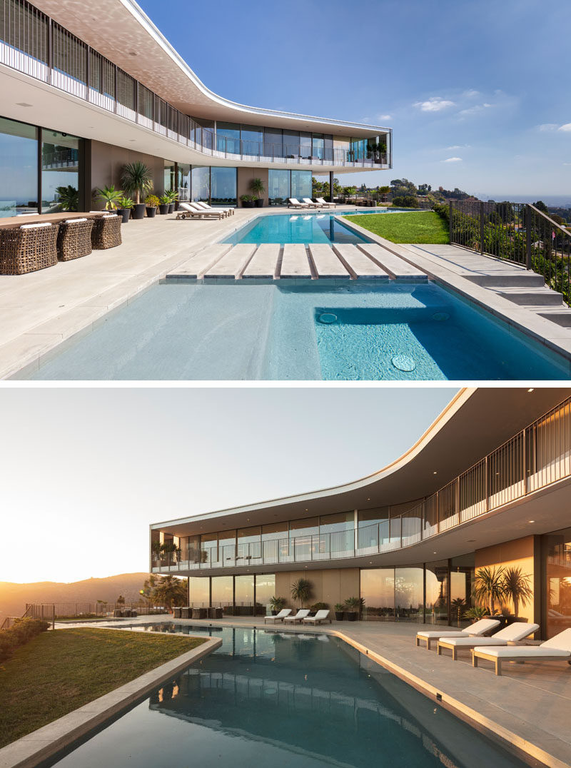 This modern house has an expansive outdoor area that's ideal for entertaining, and includes a kitchen, two fire pits, and an LED-lit pool, as well as uninterrupted views of Los Angeles in the distance. #ModernHouse #OutdoorSpace #SwimmingPool