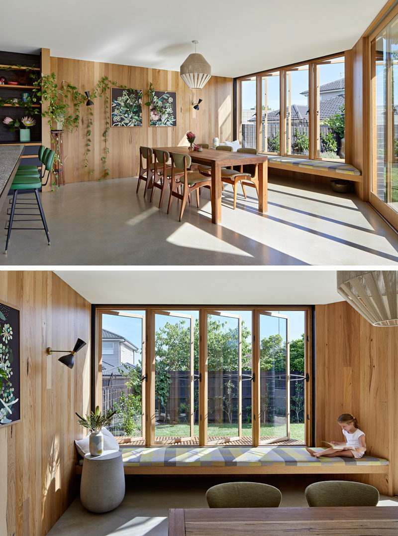 A built-in window seat pops out from this dining room to give the kitchen and dining area light and views of the backyard. #WindowSeat #DiningRoom #Windows
