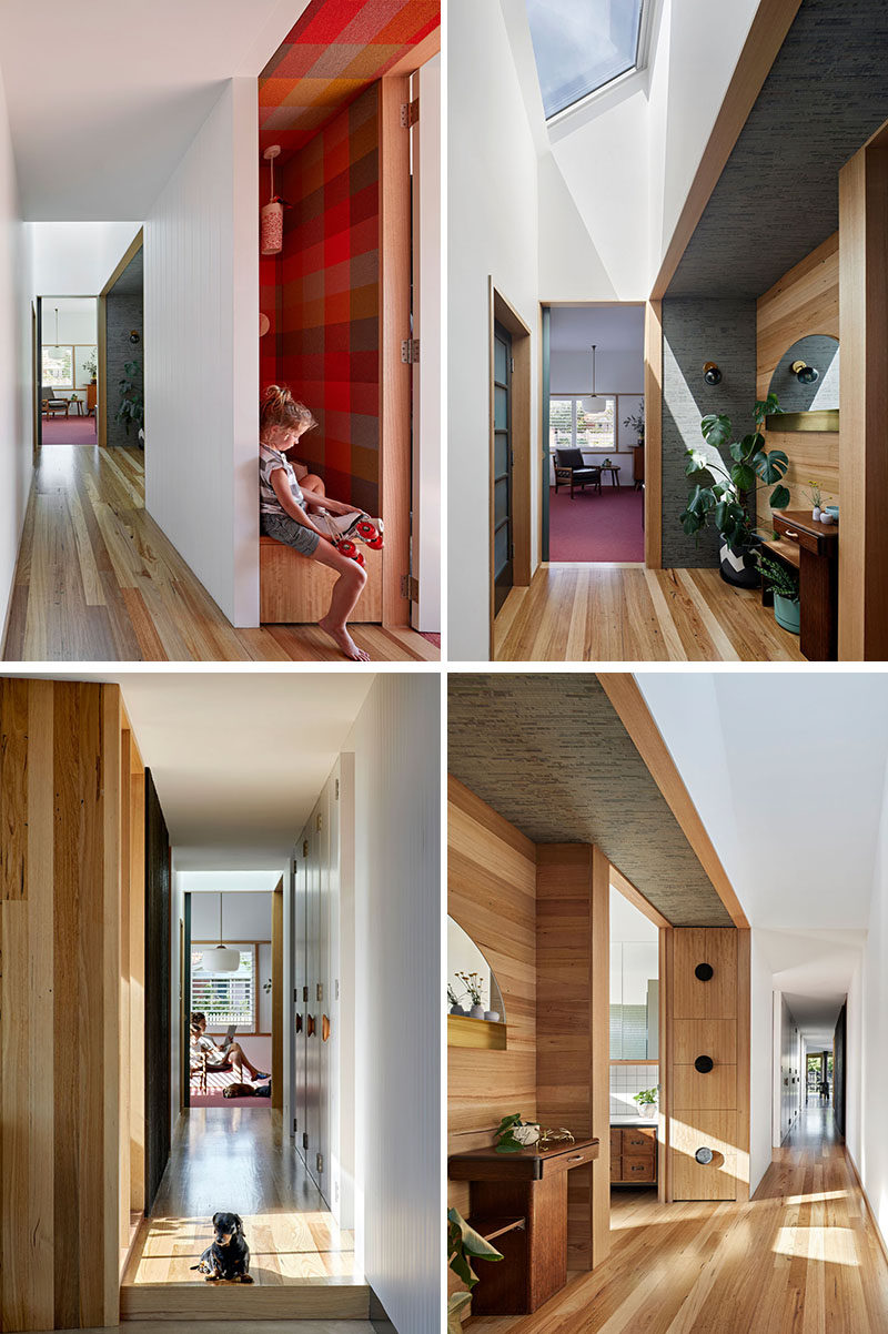 This hallway that connects the new additional to the original rooms of the house, has a skylight to keep it bright, while wood flooring adds warmth. #Hallway #InteriorDeisgn