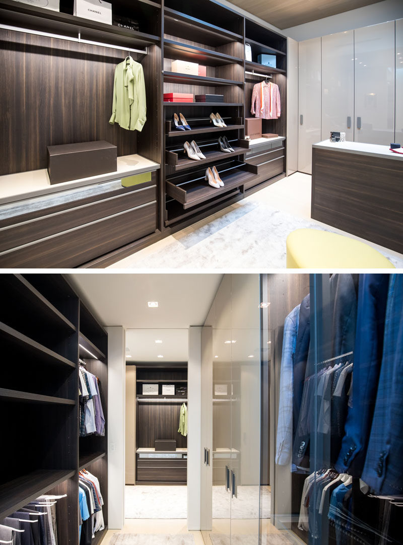 The master suite in this modern house has a large walk-in closet with plenty of room for hanging clothes, displaying shoes, and storing folded garments. #WalkInCloset #Closet