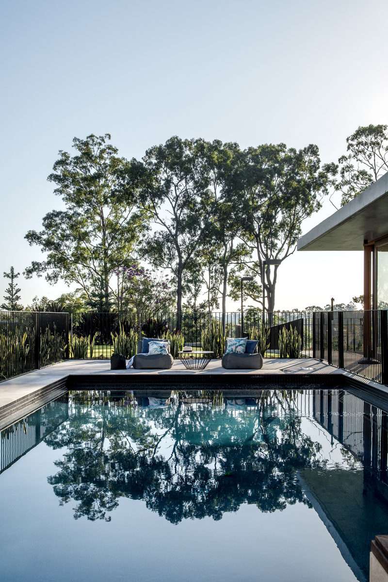 A swimming pool with views of the surrounding bush is ideal for cooling off on a hot summer day. #SwimmingPool