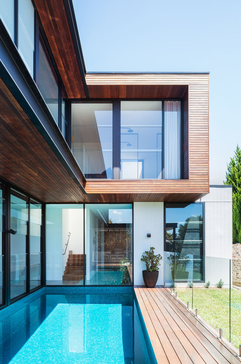 This modern house has a long swimming pool that's adjacent to the house. #SwimmingPool