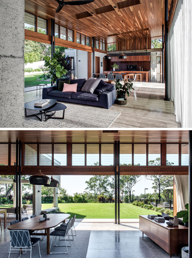 The interior of this modern house has apalette of sandblasted concrete, Spotted Gum timber and natural stone, to create a robust, warm and timeless aesthetic. #ModernHouse #InteriorDesign #WoodCeiling
