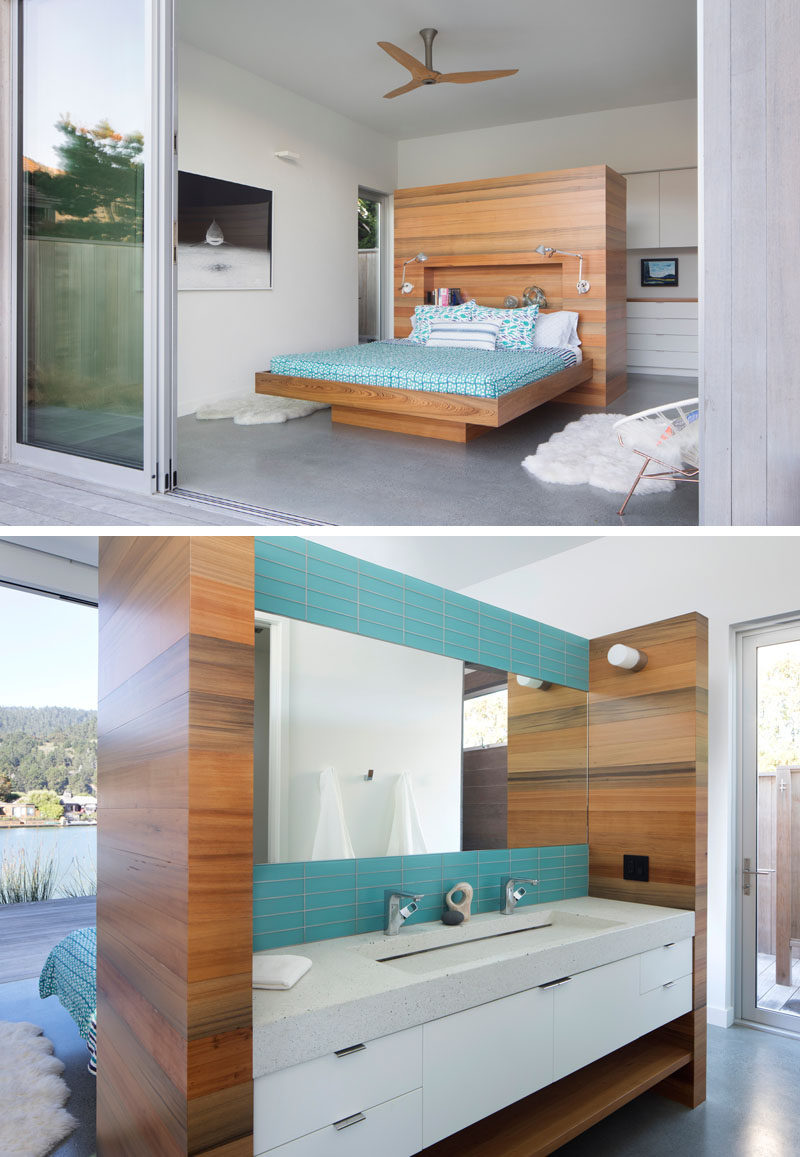 In this modern master bedroom, a wood frame supports the bed and connects to the headboard, which also acts as a surround for the bathroom vanity. #MasterBedroom #Bathroom #InteriorDesign
