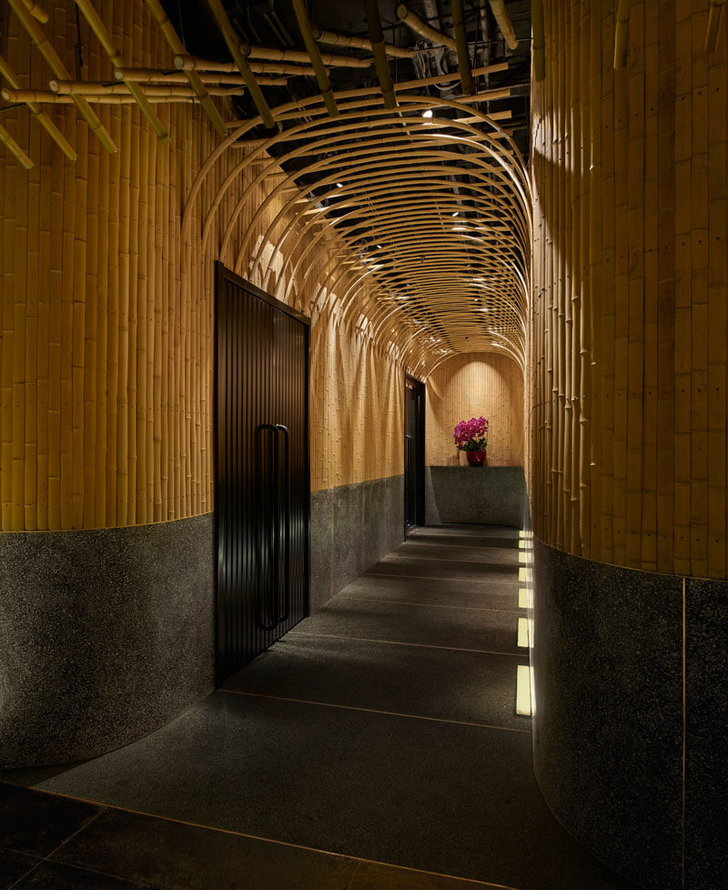 Design Detail - Imafuku Architects designed a Japanese restaurant that features a bamboo entryway that uses bamboo strips to create an arch on the ceiling. #Bamboo #RestaurantDesign #InteriorDesign