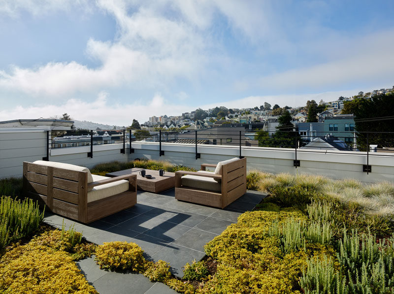 On this roof deck, there's a small sitting area that's surrounded by a succulent garden. #RoofDeck #SucculentGarden #GreenRoof