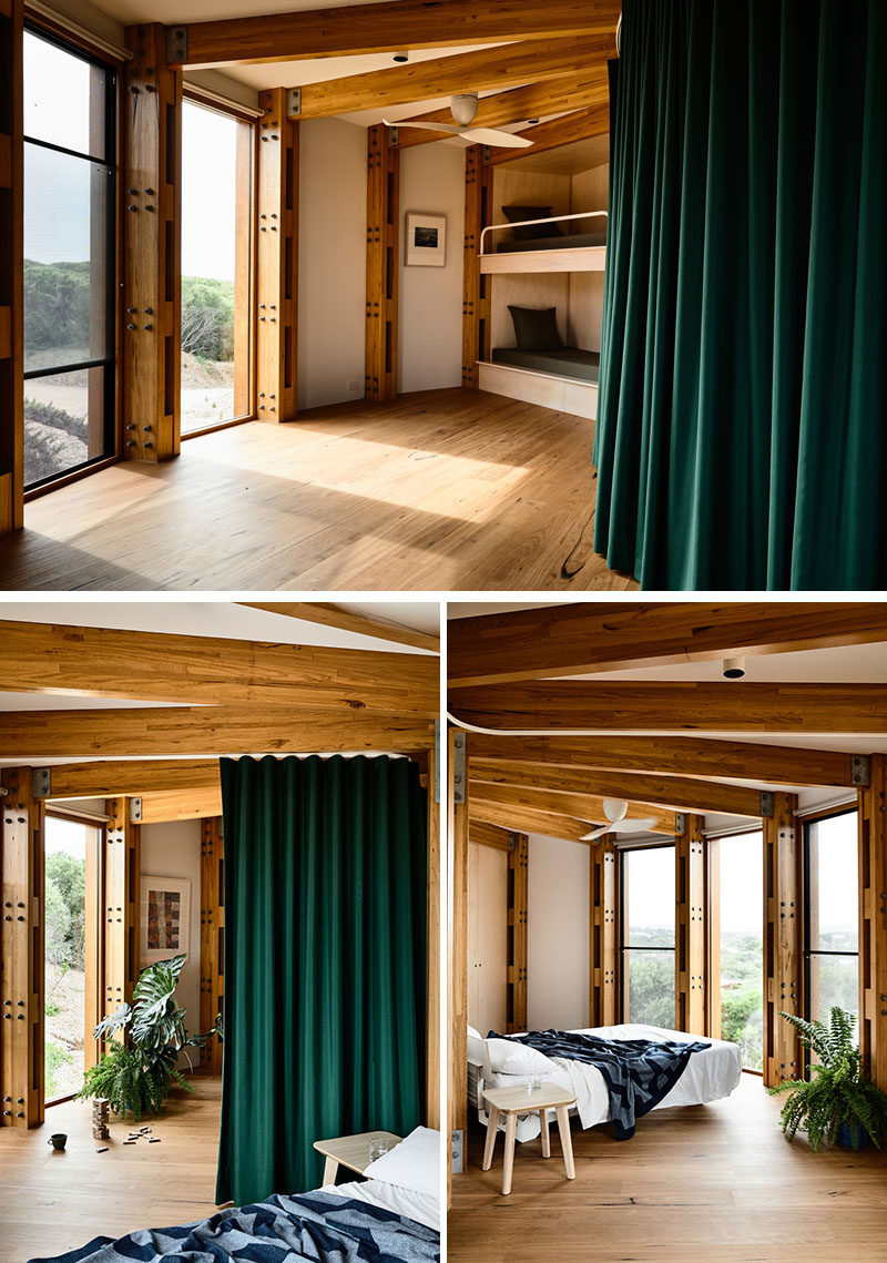 Unlike a traditional bedroom layout, the upstairs sleeping area of this modern circular house, is essentially one bunk room, separated by curtains, allowing the space to be used as a second living or games room. #Bedrooms #CircularHouse