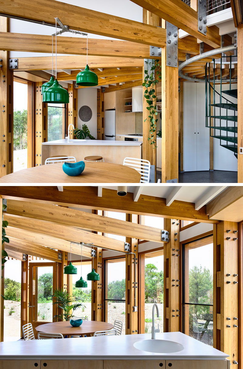 The ground floor of this circular house is dedicated to the social areas of the home, with the dining room and kitchen sharing the same space. #CircularHouse #Kitchen