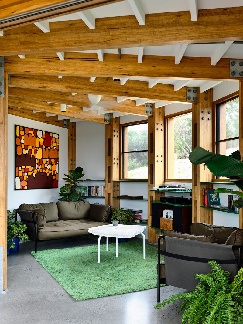 Windows provide views of thebush, rugged sand dunes, and scrub, that surround this circular house. #LivingRoom #CircularHouse