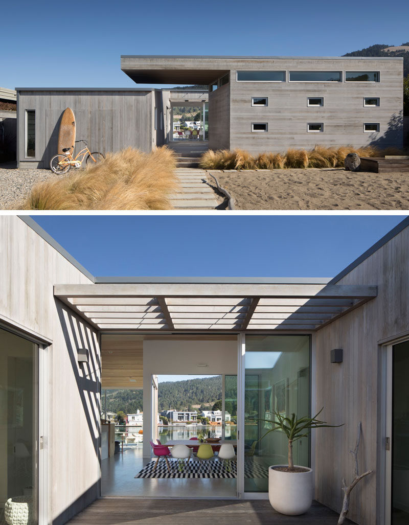 The exterior of this modern house is clad in clear-heart western red cedar, that's been stained grey for a weathered look. #Architecture #WoodSiding #ModernHouse