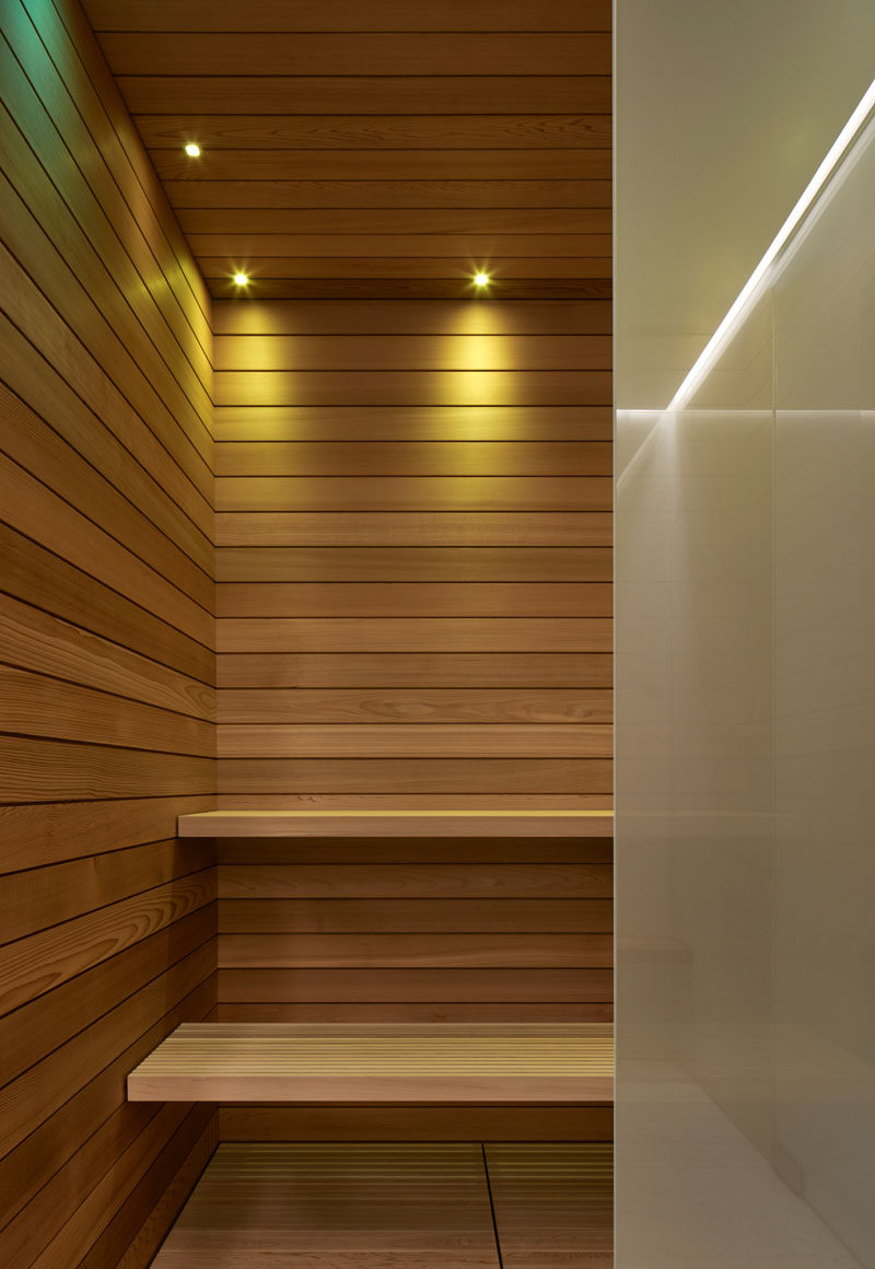 This wood-lined sauna is part of a modern pool house. #Sauna