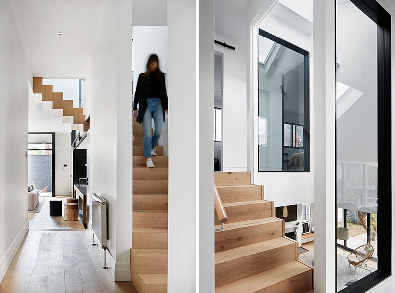 In this renovated home, the wood stairs that connect the various levels of the house can be seen from the hallway and living areas. #Stairs
