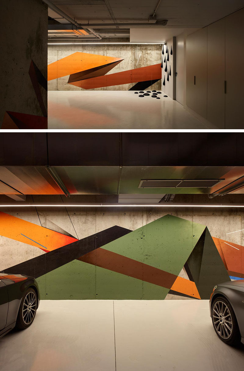 This garage features a mural by the artist Remi Rough, as well as a sculpture by Fred Wilson. #Mural #Art #Garage