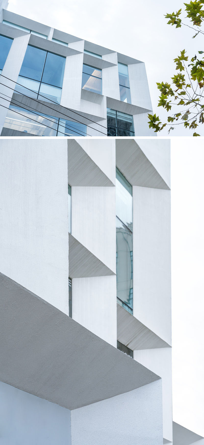 The simple white exterior of this modern office building features angled frames, and is like a beacon of light for the surrounding neighborhood. #ModernOfficeBuilding #Architecture