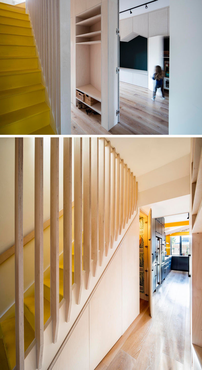 In this updated house by Woodrow Architects, a hallway runs between the playroom and the stairs, creating space for open shelving, while underneath the yellow stairs, there's a small powder room. #YellowStairs #Hallway #OpenShelving Visit Woodrow Architect's website here > https://www.wdrw.co.uk