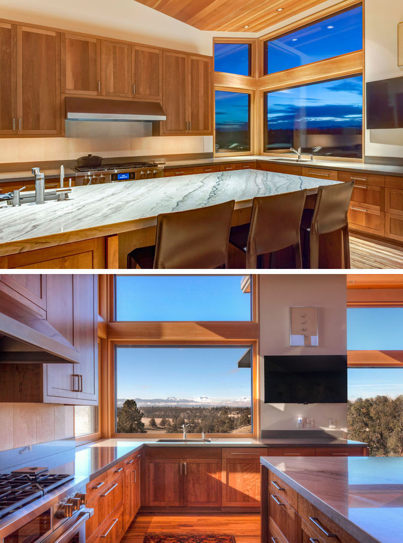 This contemporary kitchen with wood cabinets visually connects to the living room, and a large island provides plenty of counter space for cooking and entertaining. #WoodKitchen #ContemporaryKitchen #KitchenDesign