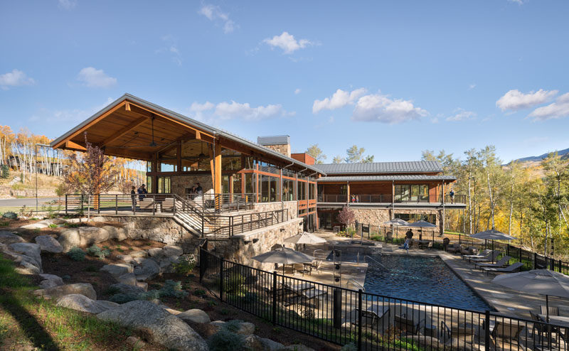 Craine Architecture has recently completed a new activity center for theSummit Sky Ranch in Silverthorne, Colorado, that features plenty of wood, stone, and glass. #Architecture #SwimmingPool